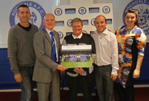 RAFC presenting Crown Oil with team photo and programme